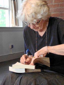 Pat signing books